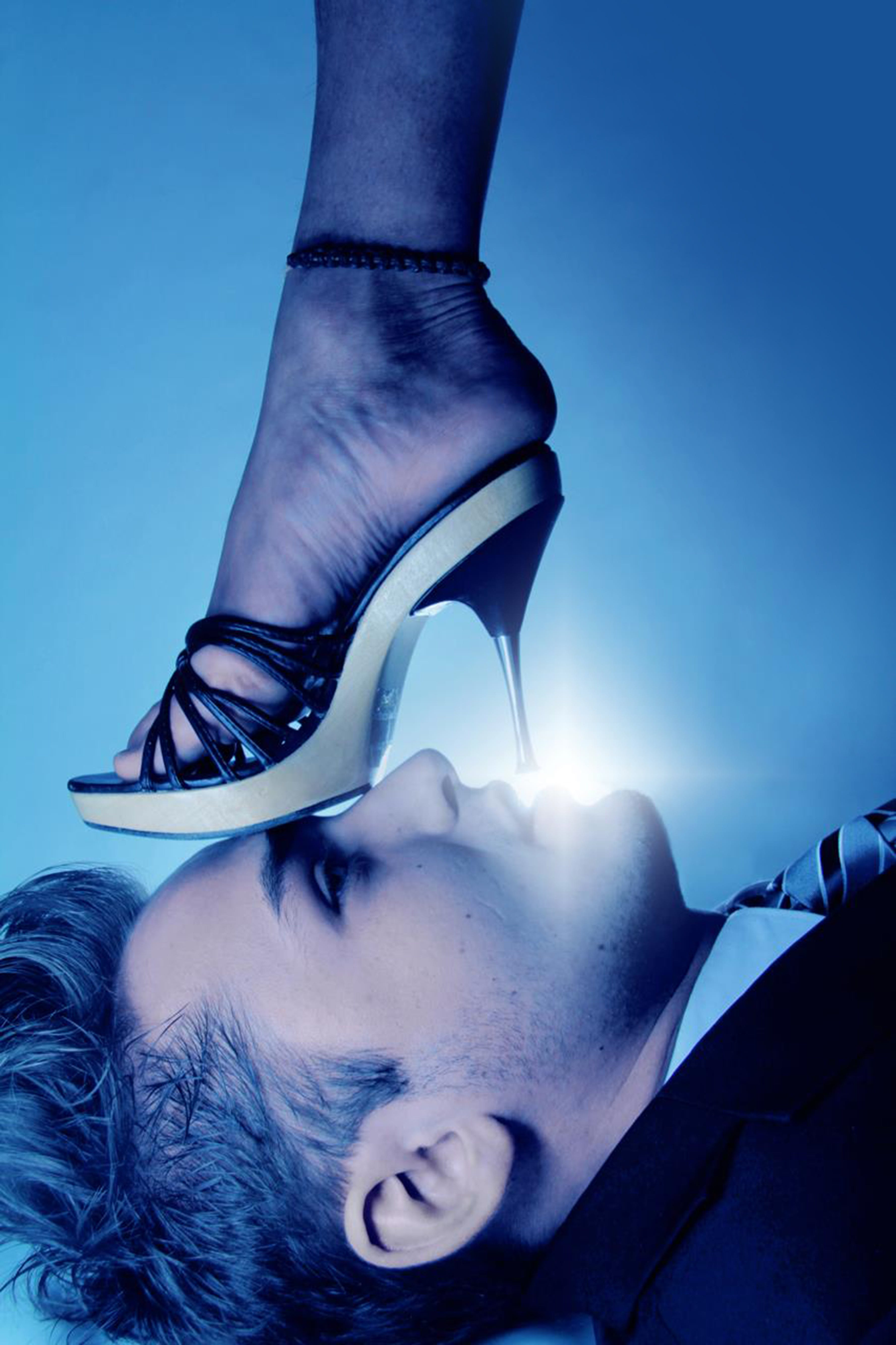 Stiletto Sandal on Men's Face Wallpaper