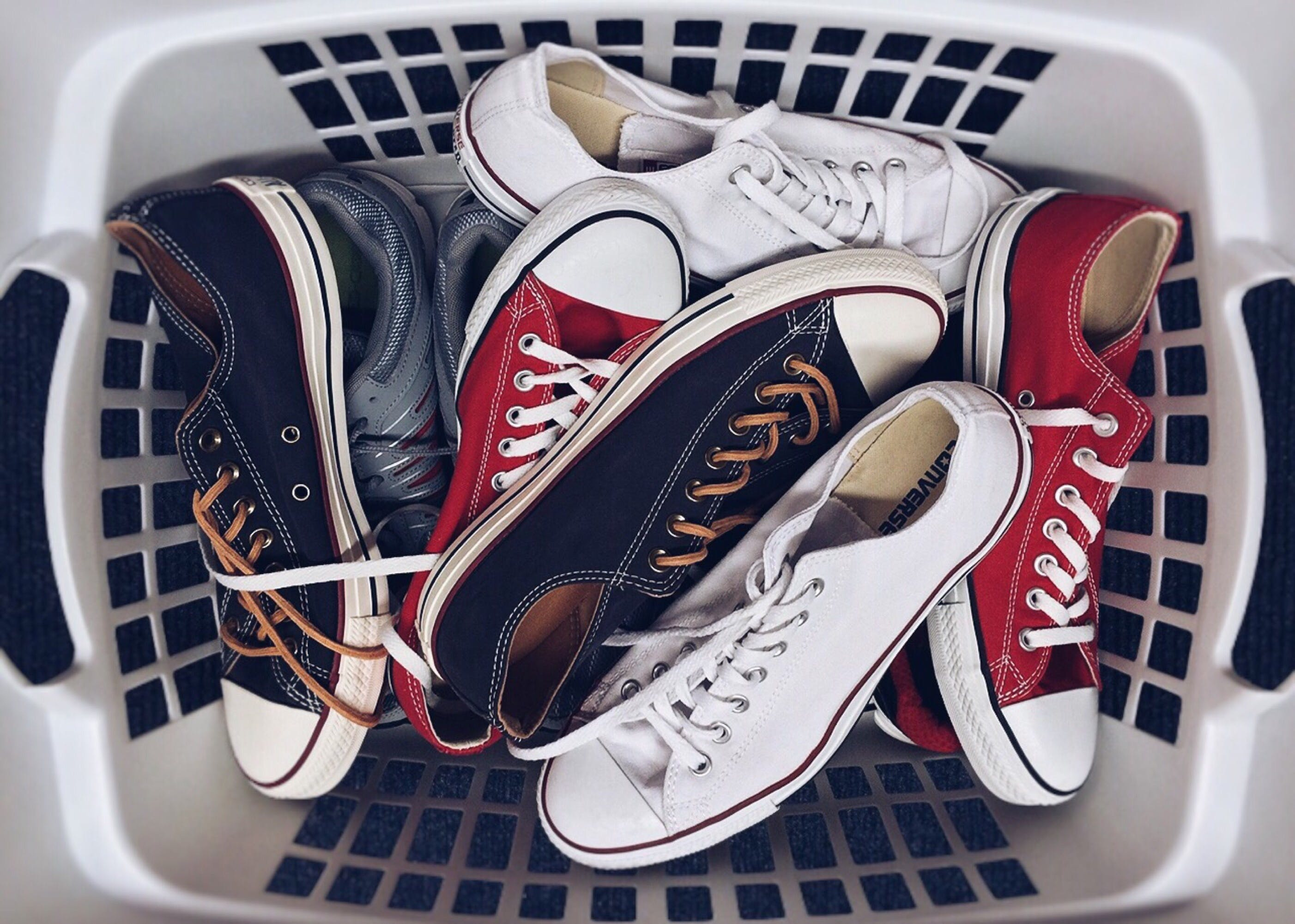 Laundry basket filled with shoes