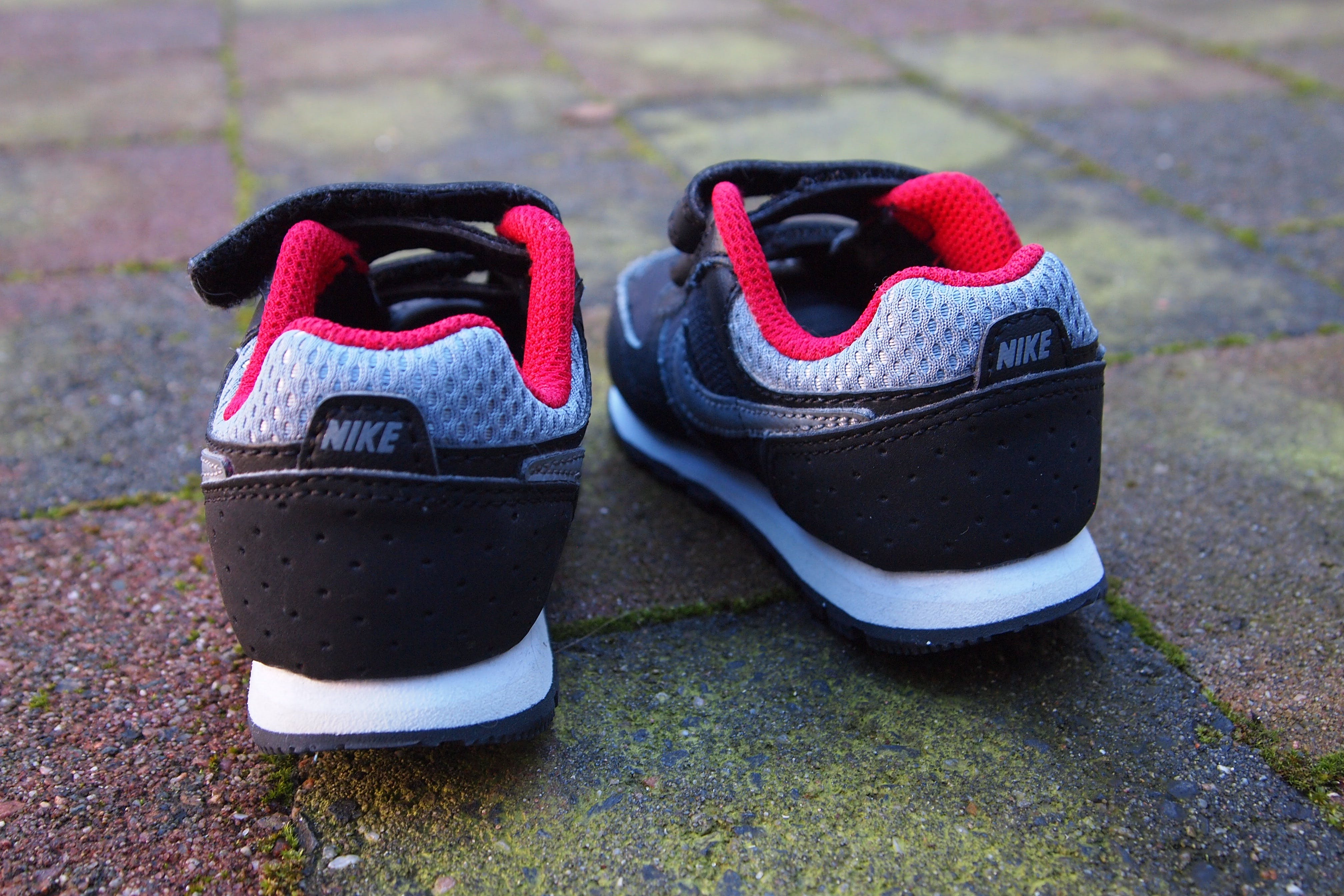 Pair of Gray-black-and-red Nike Sneakers