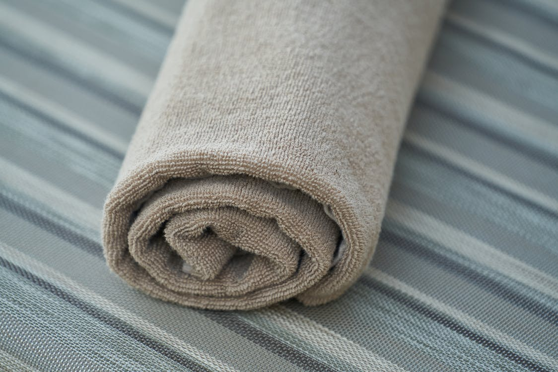 Rolled Gray Towel in Closeup Photo