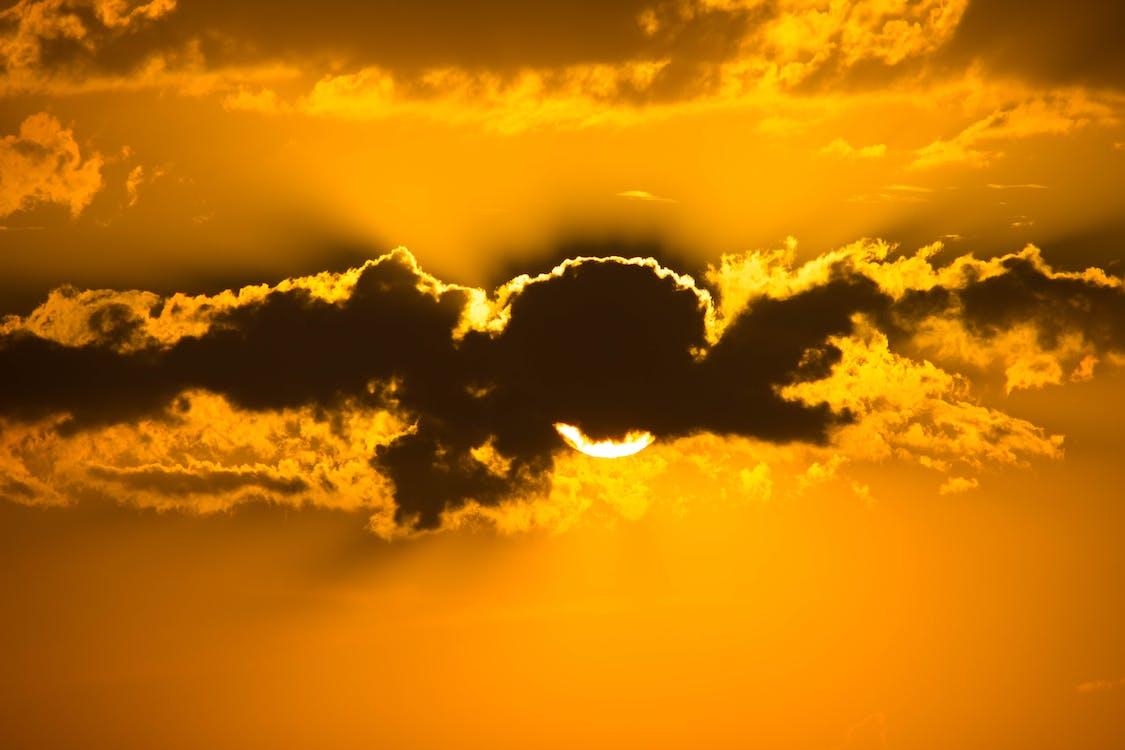 Sun Hiding Behind Clouds