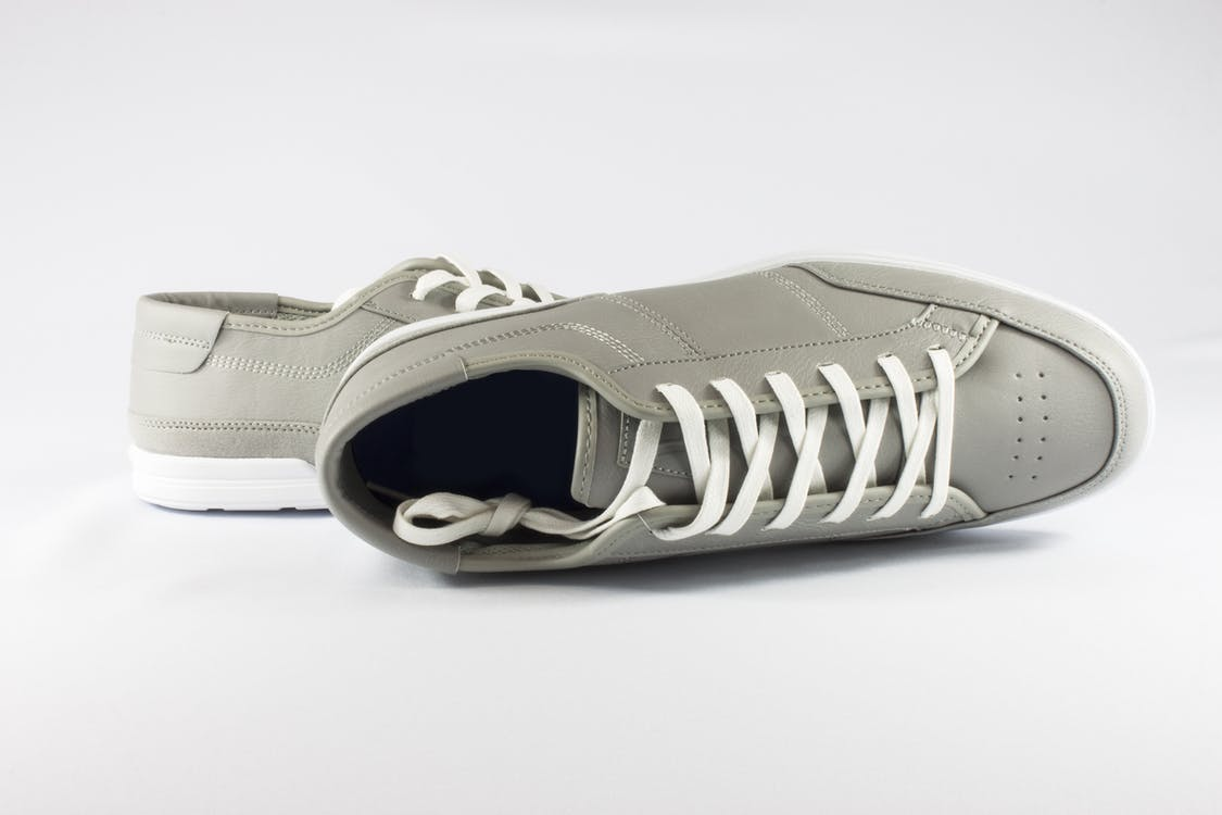 Pair of Gray Low-top Sneakers on White Floor
