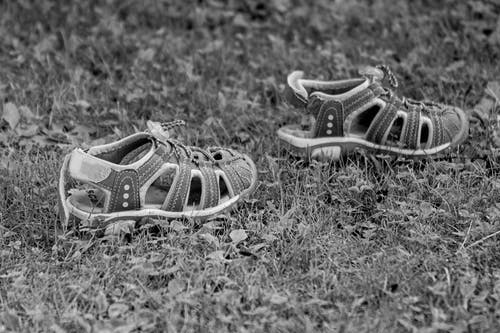 Pair of Toddler's Gray Sandals on Grass