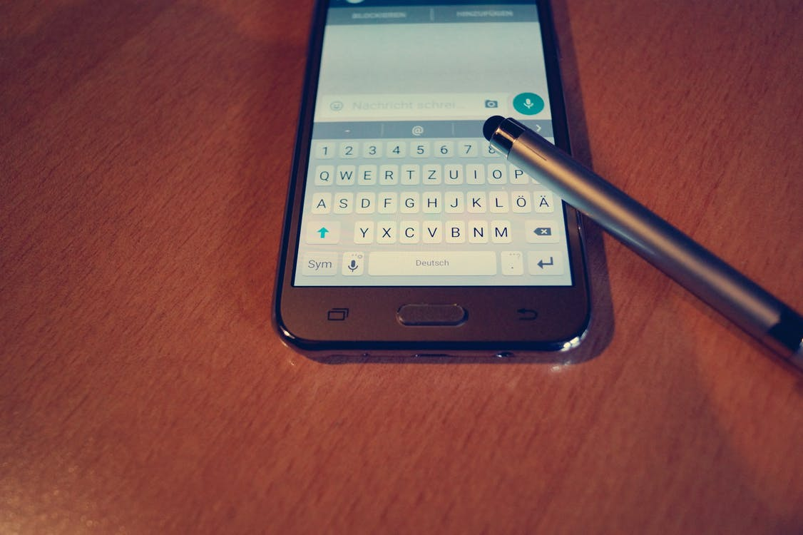 Silver Samsung Android Smartphone With Stylus Pen