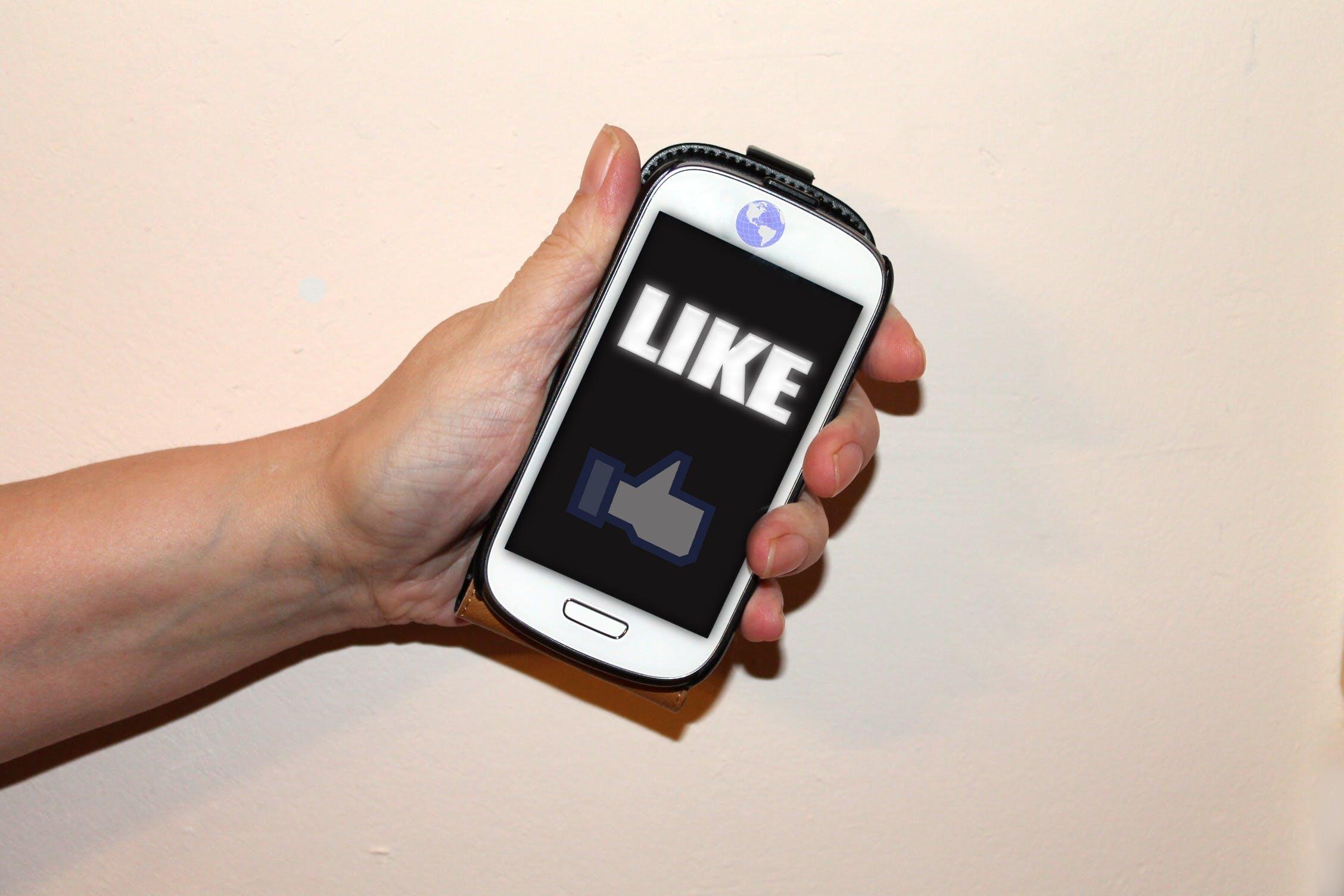 Free stock photo of mobile phone, facebook, thumb, like
