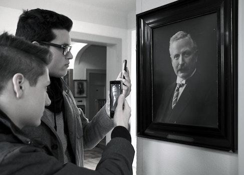 Free stock photo of black-and-white, people, taking photo, men