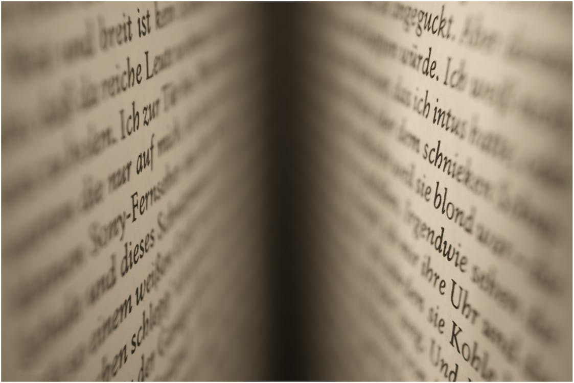 Selective Focus Photography of Open Book