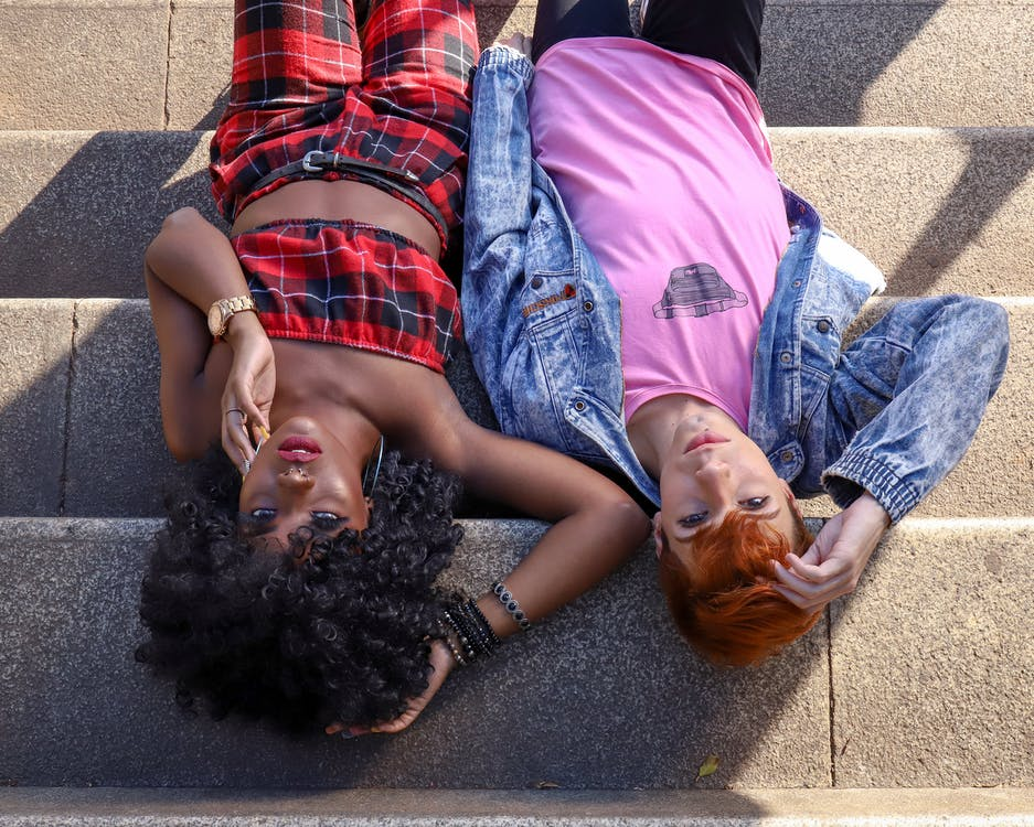 People Lying on Concrete Stairs