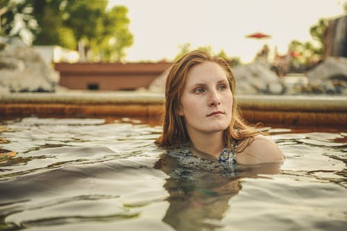 Close-Up Photo of Woman in Swimming Pool