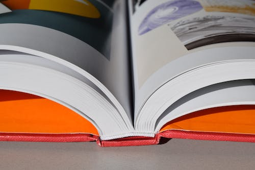 Opened Red Book on Gray Surface
