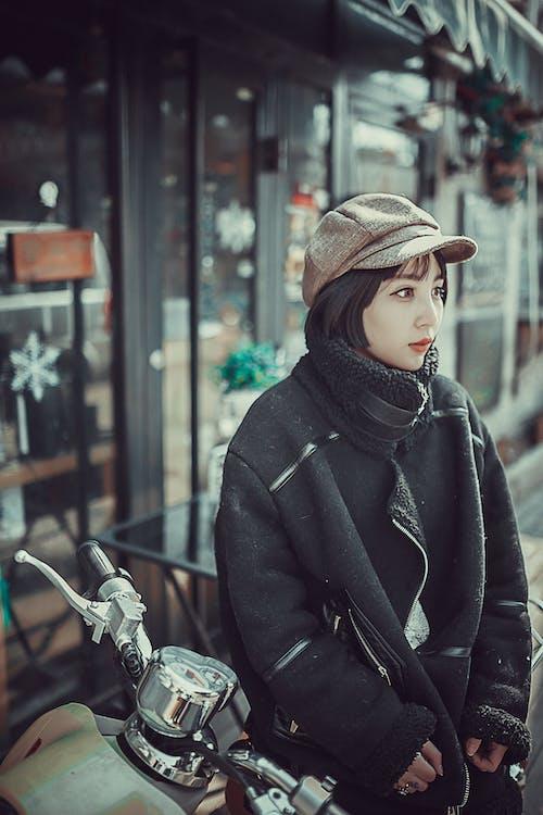 Woman in Black Coat Sitting on Motorcycle