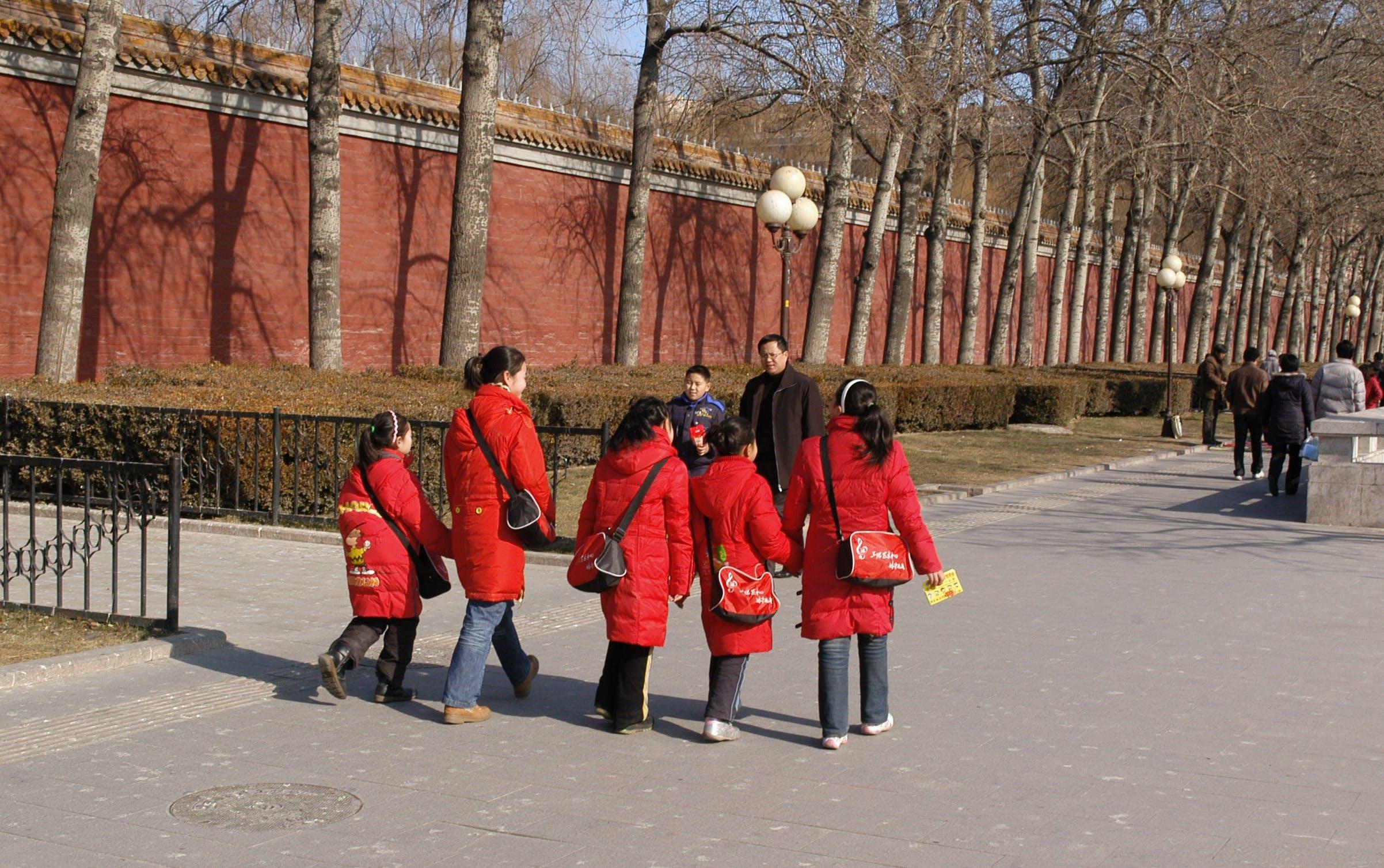 Free stock photo of red, street, walking, jacket