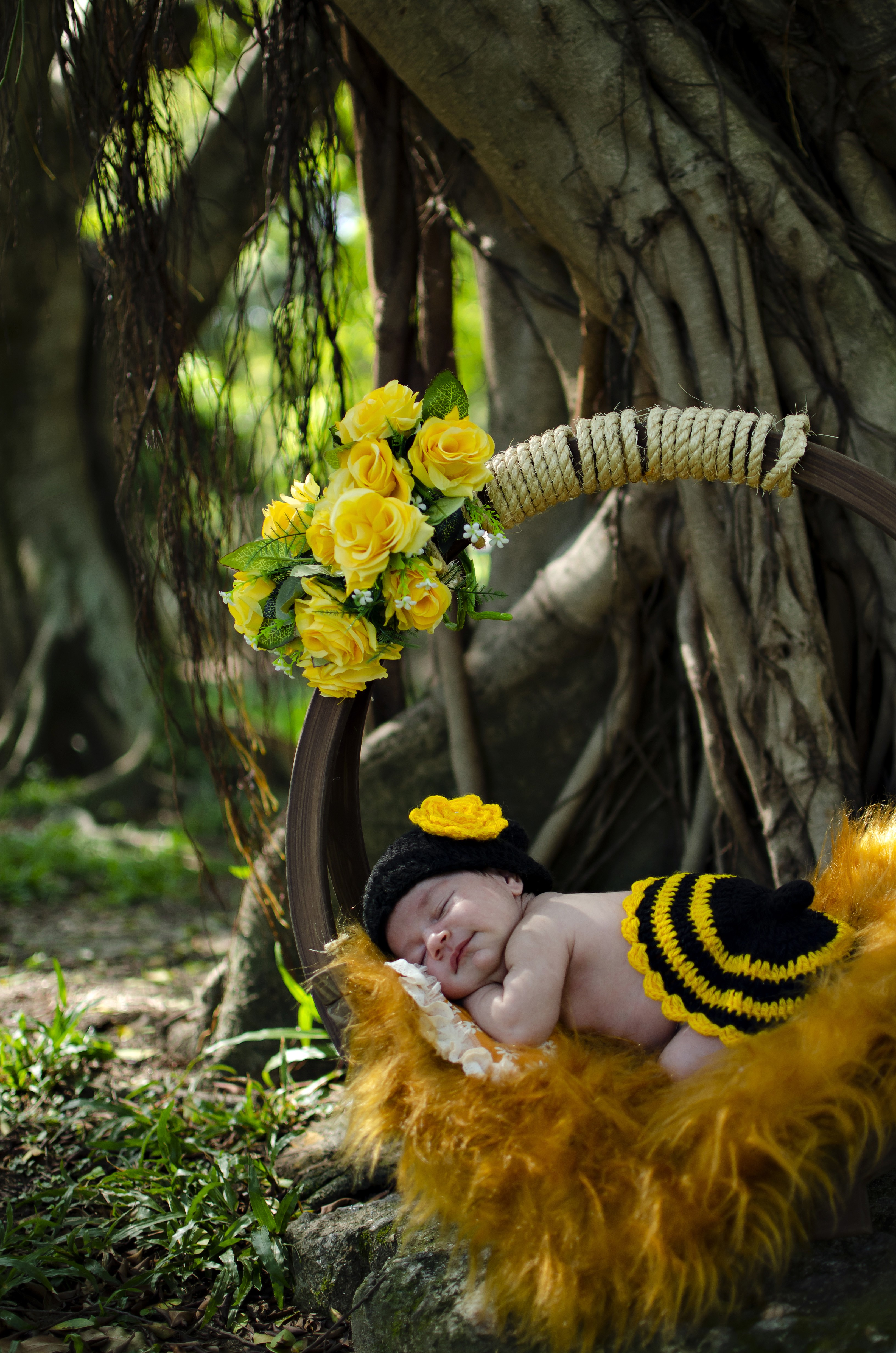 baby Sleeping on Brown Basket Beside Tree