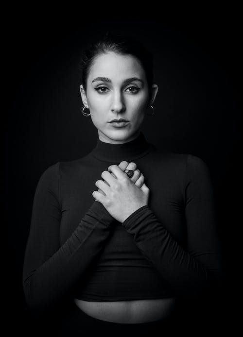 Monochrome Photo of Woman Wearing Turtleneck Top
