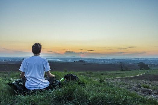 Kostenloses Stock Foto zu landschaft, sonnenuntergang, person, entspannung