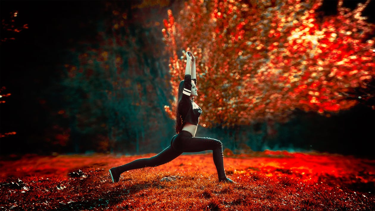 Woman Doing Yoga Near Tree