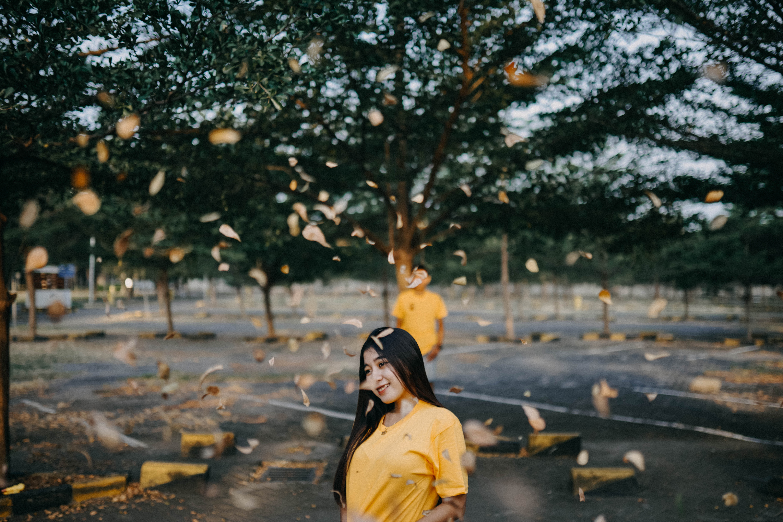 Shallow Focus Photo of Woman Wearing Yellow Shirt