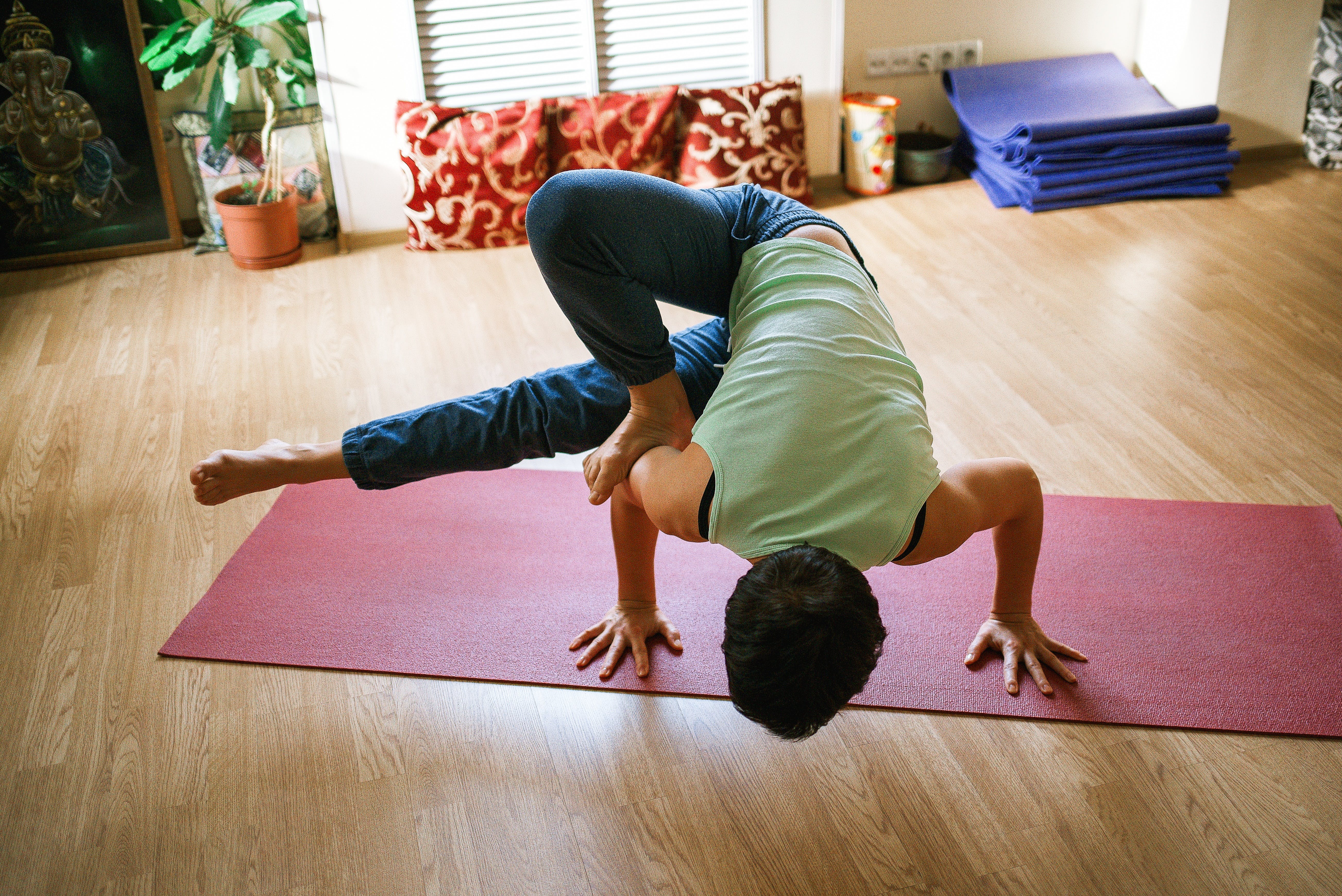 Man Making Yoga on Yoga Mat