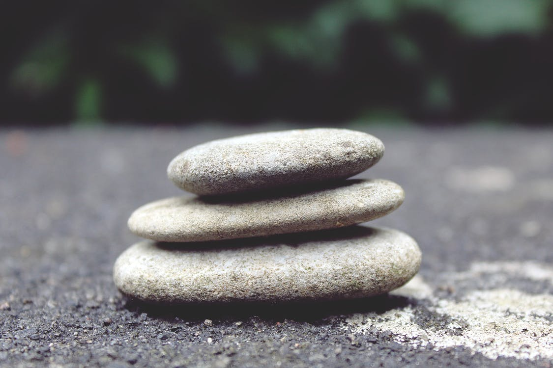 Selective Focus Photography of Cairn Stone