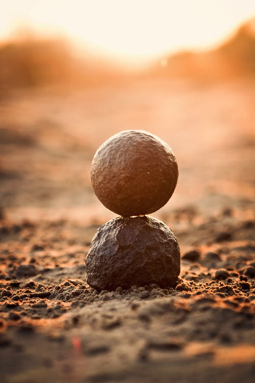 Selective Focus Photography of Round Black Rock