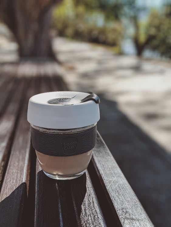 Photo Of Glass Container On Top Of Wooden Bench