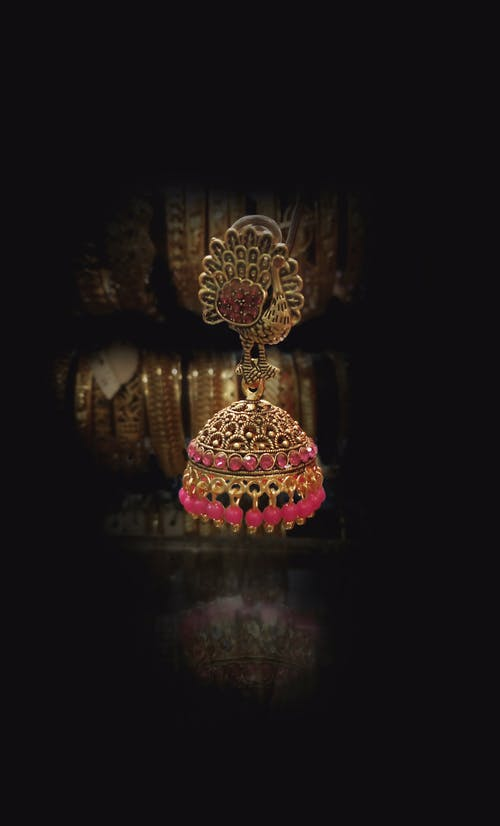 Gratis stockfoto met goud, indiase traditie, licht effect, oorbellen