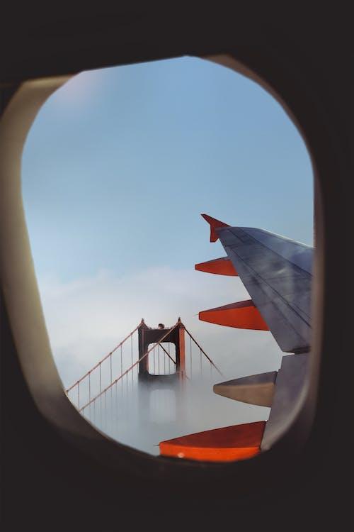 Foto d'estoc gratuïta de ala de l'avió, assolellat, avió, cel