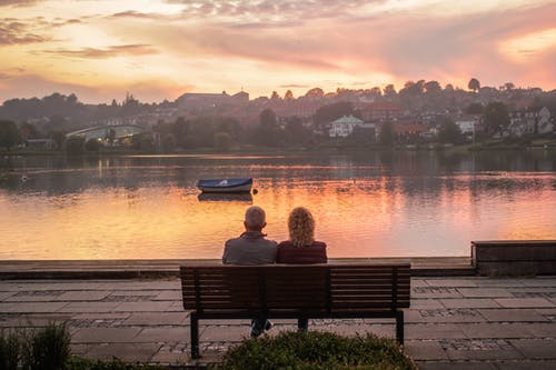 Two Person Sitting on Bench