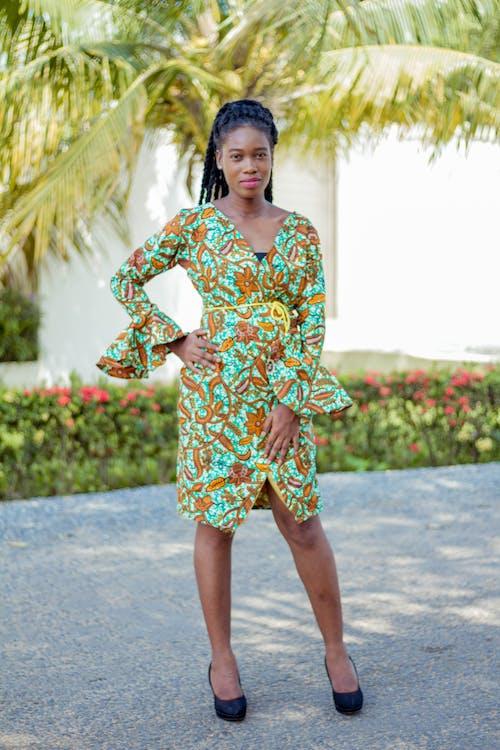 Woman Wearing Green Floral Long Sleeve Dress