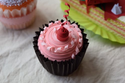 Pink Icing-covered Cupcake