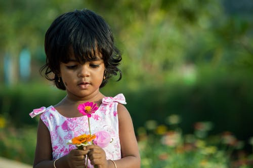 Free stock photo of baby, cute girl, girl with flower, kid