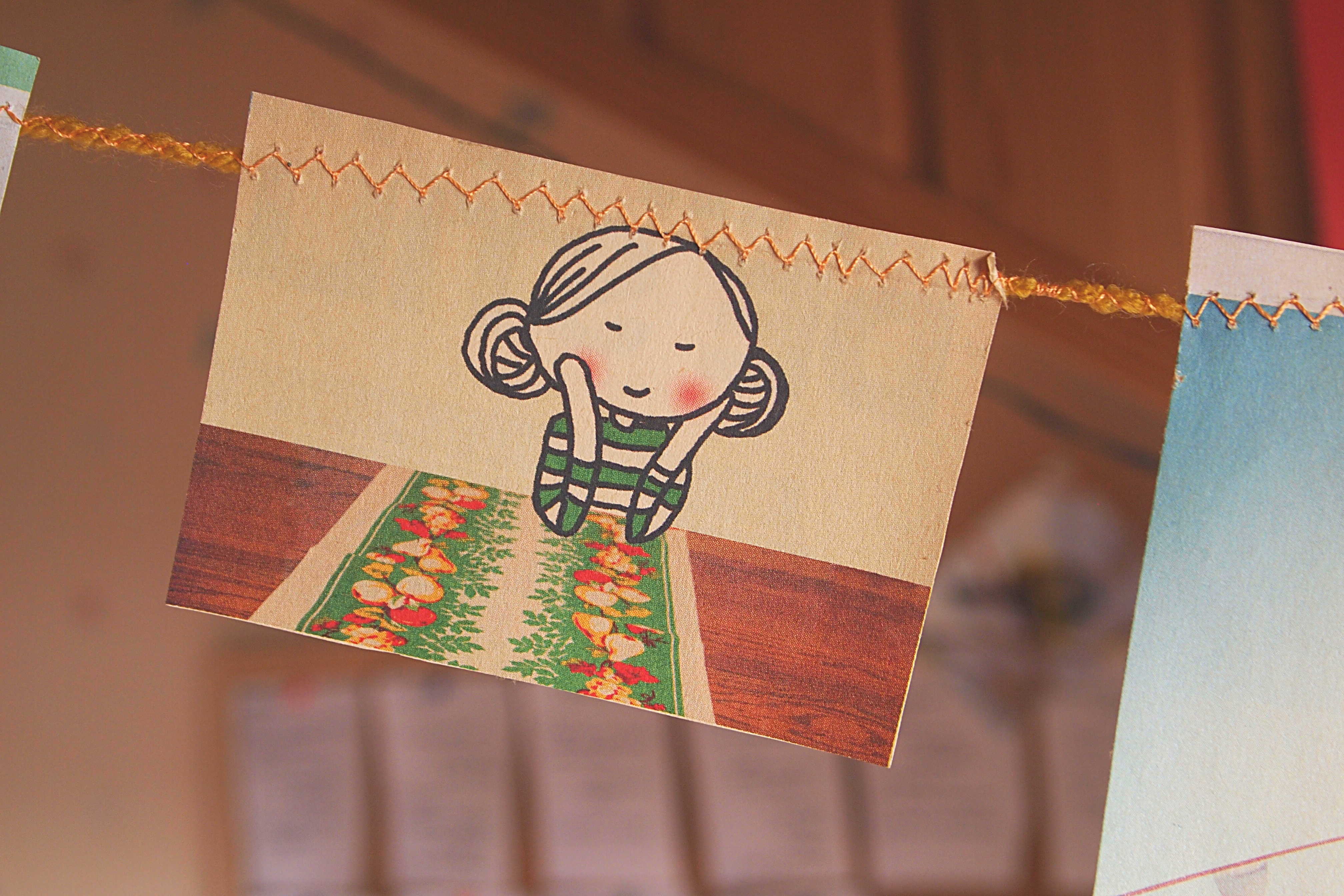 Drawing of Girl Hanging on Yarn