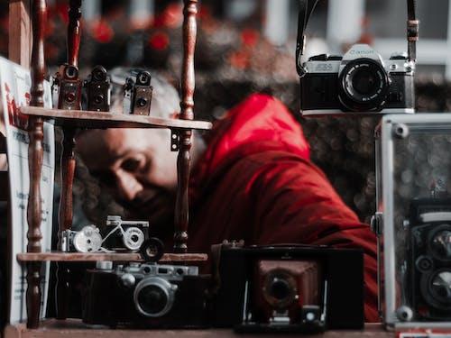 Photo Of Man Near Cameras