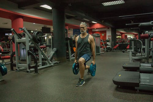 Kostenloses Stock Foto zu fitness, fitnessstudio, gesund, gewichte