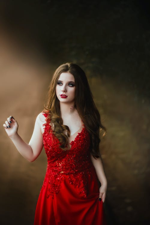 Photo of Woman Wearing Red Gown