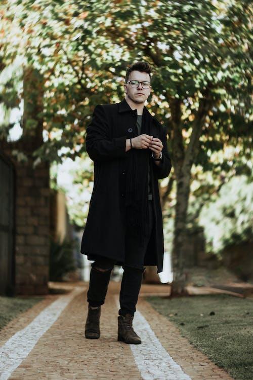 Photo of Man Wearing Black Coat
