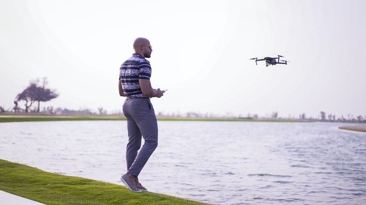20-25 years old man, casual clothing, drone