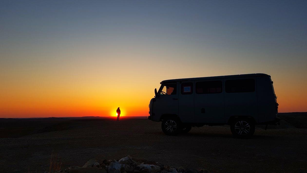 Blue Enclose Van during Sunset Scenery