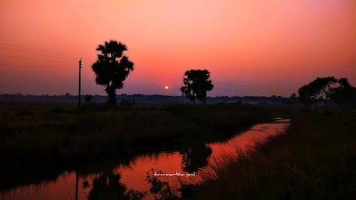 Fotobanka sbezplatnými fotkami na tému dedina, India, krásny západ slnka, rieka