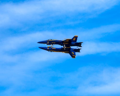 Two Blue and Yellow Airplanes on Skies