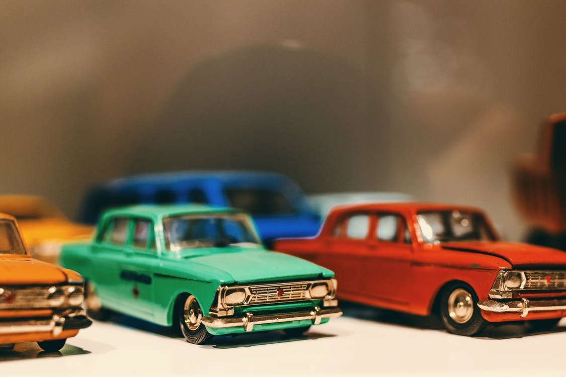 Selective Focus Photography of Classic Car Die Cast Models
