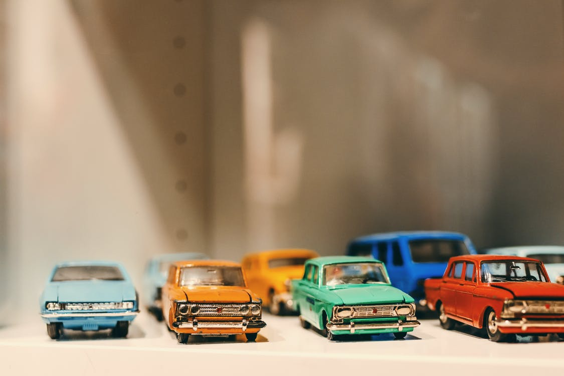 Selective Focus Photography of Die Cast Model Toy Cars