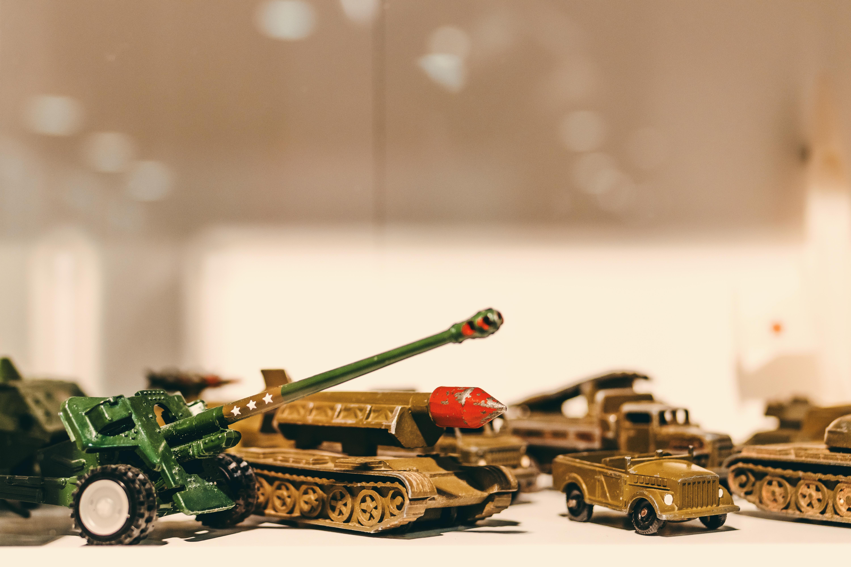 Selective Focus Photography of Die Cast Model Combat Vehicles
