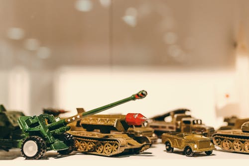 Selective Focus Photography of Die Cast Model Combat Vehicles