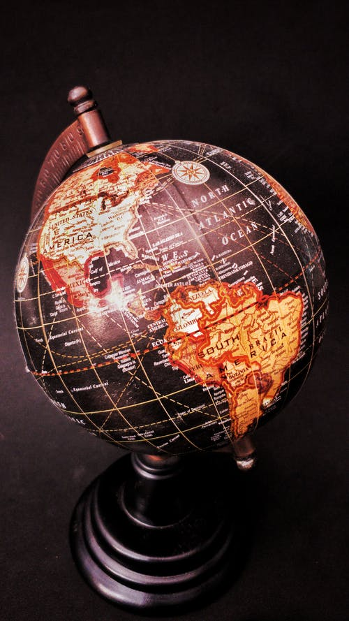 Black and Brown Desk Globe Close-up Photography