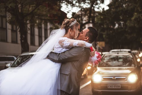Groom and Bridge Kissing Each Other