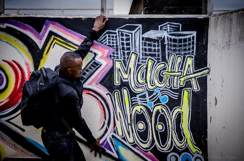 Gratis stockfoto met afrikaanse graffiti, blockbuster, deegroller, domming