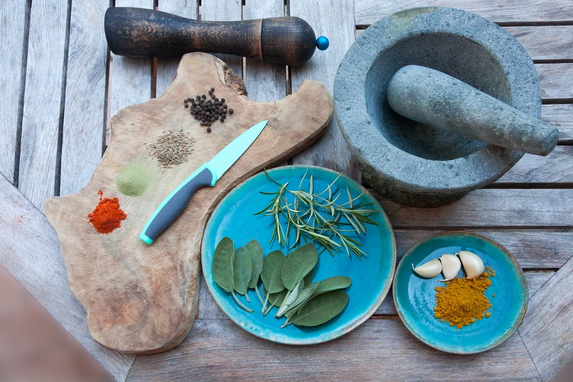 Spices on Plate With Knife
