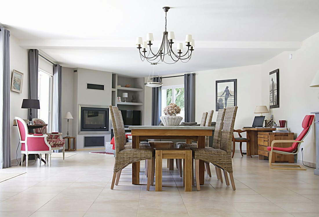 Rectangular Brown Wooden Dining Table and Six Gray Chairs Indoors