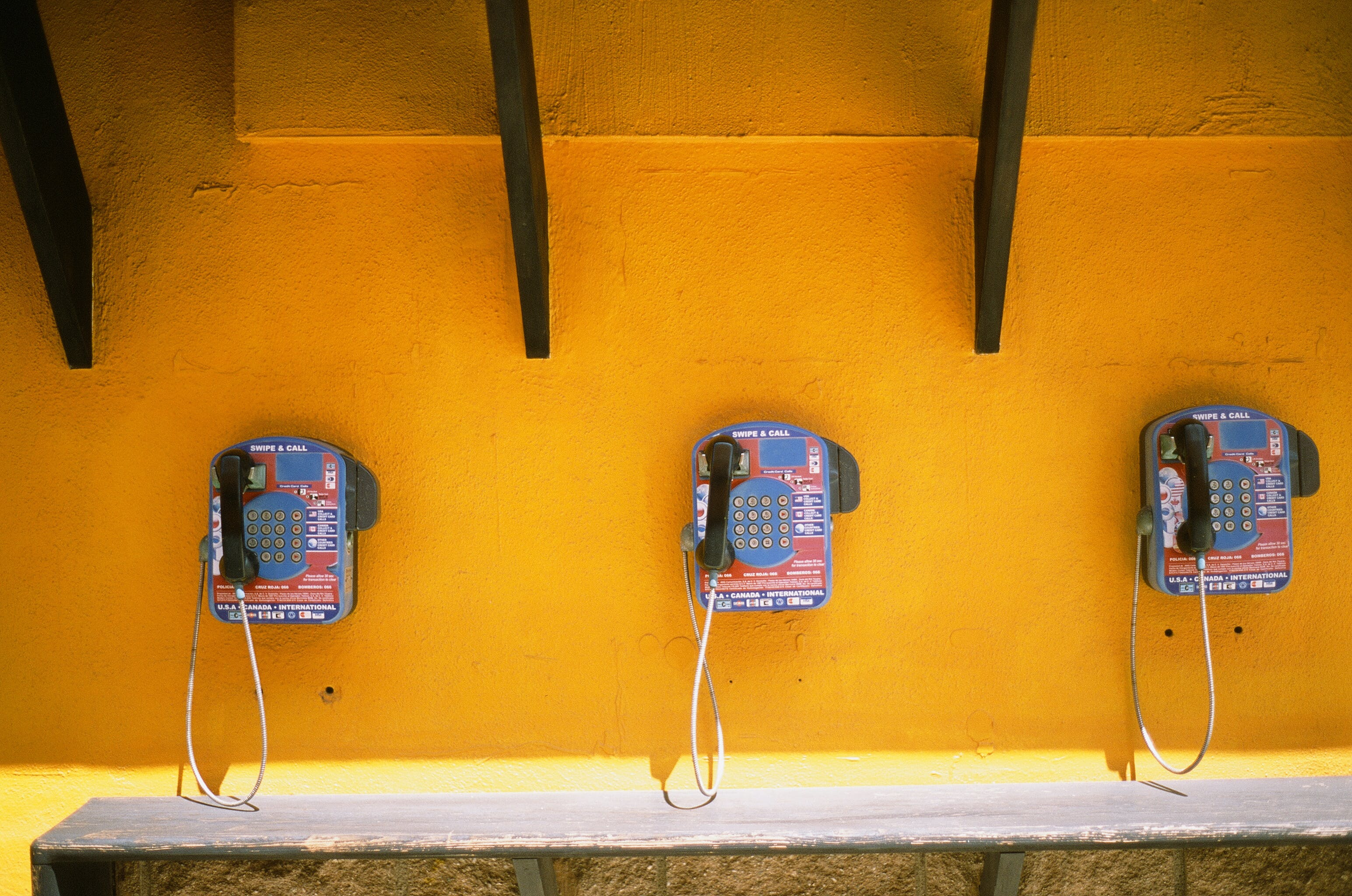 Three Blue-and-black Telephones